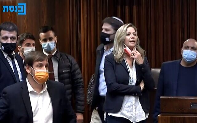 Blue and White MK Miki Haimovich votes in the Knesset against a bill that might have staved off elections, December 21, 2020 (Knesset channel screenshot)