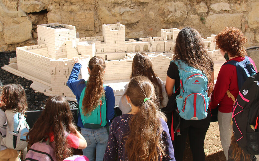 Visitors look at a model of the Old City's citadel at the Tower of David Museum in Jerusalem. (Shmuel Bar-Am)