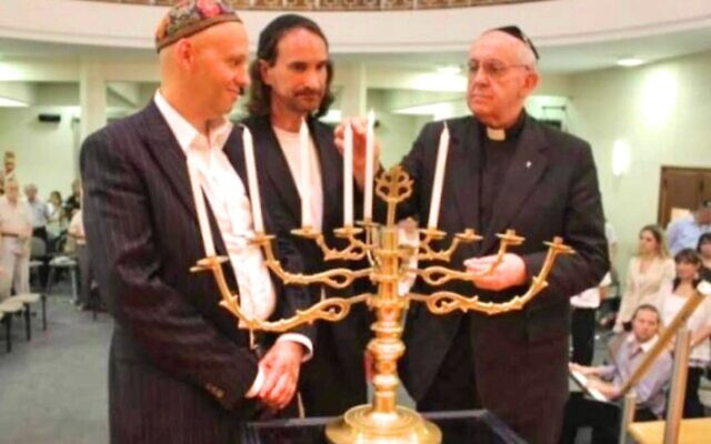Pope Francis (far right) lights candles at a 2012 Hanukkah Interfaith Celebration at a Buenos Aires synagogue with current World Union of Progressive Judaism head Rabbi Sergio Bergman. (courtesy)