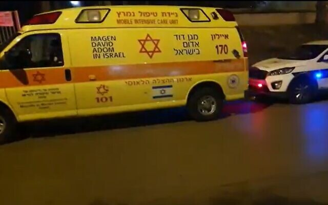 Scene outside an apartment where a woman was stabbed to death in Rehovot, December 11, 2020 (Screen grab/Channel 13)