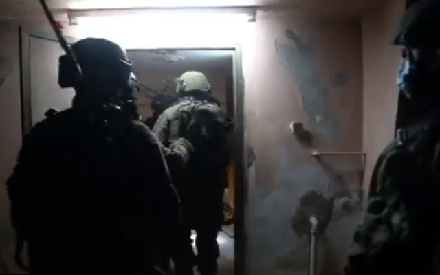 IDF troops map out the home of a Palestinian man suspected in the murder of Esther Horgen, ahead of its potential demolition, in the West Bank village of Tura, near Jenin, December 24, 2020 (IDF video screenshot)