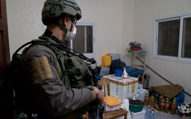 A photo released by the Israel Defense Forces on December 23, 2020, shows a soldier in the West Bank village of Qabatiya, during a raid of the home of Ahmad Abu al-Rabb. (Israel Defense Forces)