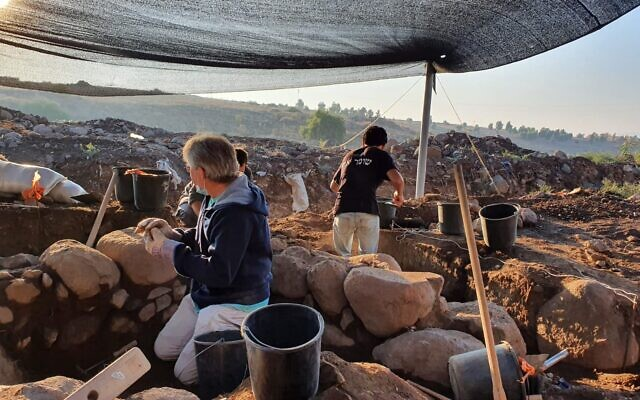 Work on the excavation of an Islamic period building in which a late 5th century CE Greek inscription, 'Christ born of Mary,' was found in secondary use, excavated in the village of et-Taiyiba (Taybeh) in the Jezreel Valley. (Einat Ambar-Armon/Israel Antiquities Authority)
