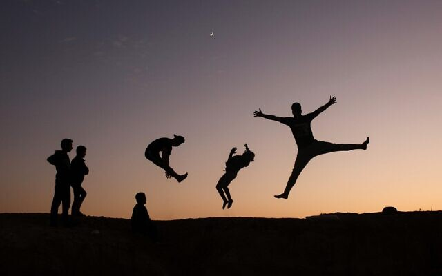 Palestinian youths practice parkour in Gaza City, on November 18, 2020. (MOHAMMED ABED/AFP)