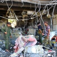 Fighters with the Saudi-backed coalition assess the damage inside the airport of Yemen's southern city of Aden on December 31, 2020, a day after explosions rocked the building, killing or injuring dozens of people. (Saleh Al-OBEIDI / AFP)