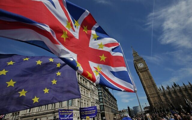 File: In this file photo taken on March 25, 2017, demonstrators holding EU and Union flags gather in front of the Houses of Parliament in Parliament Square in London (Daniel LEAL-OLIVAS / AFP)