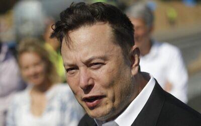 Tesla CEO Elon Musk speaks to media as he arrives to visit a construction site in Gruenheide, near Berlin, September 3, 2020. (Odd Andersen/AFP)