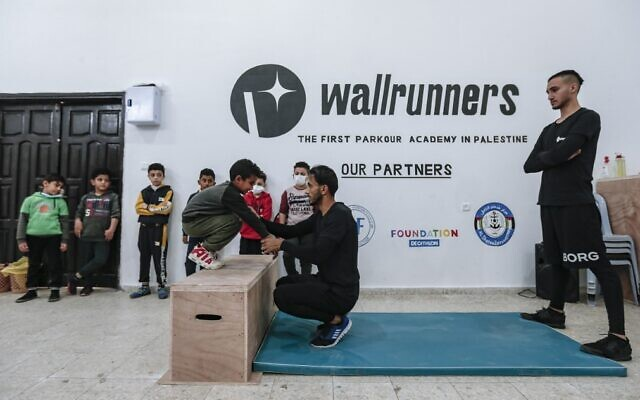 Palestinian Parkour enthusiasts exercise in a training facility in Gaza City, December 28, 2020. (AFP)
