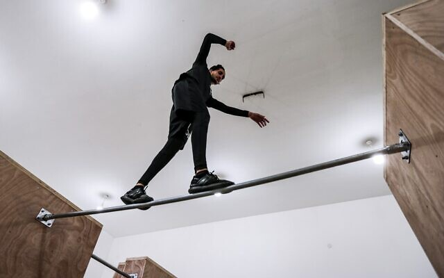 A Palestinian youth trains at the Wallrunners Parkour Academy's training facility in Gaza City on December 28, 2020. (MAHMUD HAMS / AFP)