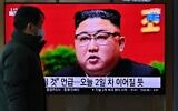 A man watches a television screen showing news footage of North Korean leader Kim Jong Un attending the 8th congress of the ruling Workers' Party held in Pyongyang, at a railway station in Seoul on January 6, 2021. (Jung Yeon-Je/AFP)