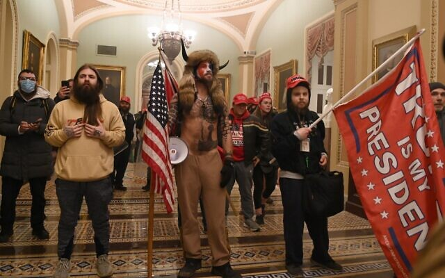 Supporters of US President Donald Trump, including member of the QAnon conspiracy group Jake A, aka Yellowstone Wolf (C), enter the US Capitol on January 6, 2021, in Washington, DC. (Saul LOEB / AFP)