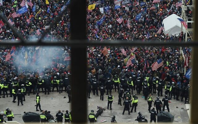 Police hold back supporters of US President Donald Trump as they gather outside the US Capitol's Rotunda on January 6, 2021, in Washington, DC. (Olivier Douliery/AFP)
