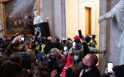 Supporters of US President Donald Trump protest in the US Capitol's Rotunda on January 6, 2021, in Washington, DC. (SAUL LOEB / AFP)