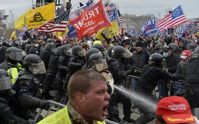 Trump supporters clash with police and security forces as they try to storm the US Capitol, in Washington on January 6, 2021. (Joseph Prezioso/AFP)