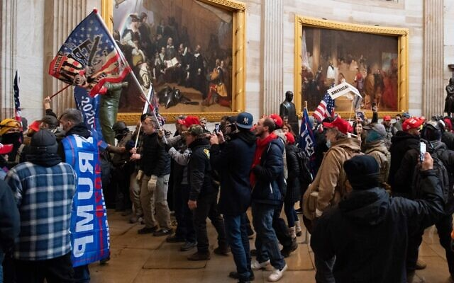 Supporters of US President Donald Trump protest in the US Capitol Rotunda on January 6, 2021, in Washington, DC. - Demonstrators breeched security and entered the Capitol as Congress debated the a 2020 presidential election Electoral Vote Certification. (SAUL LOEB / AFP)