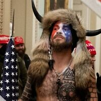 Supporters of US President Donald Trump, including Jake Angeli, a QAnon supporter known for his painted face and horned hat, protest in the US Capitol on January 6, 2021, in Washington, DC (SAUL LOEB / AFP)