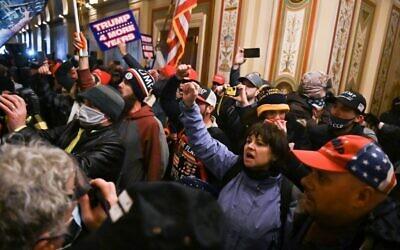 Supporters of US President Donald Trump protest inside the US Capitol on January 6, 2021, in Washington. (Roberto Schmidt/AFP)