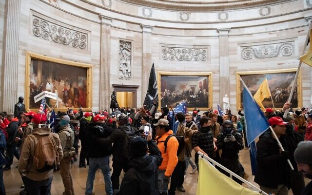 Supporters of US President Donald Trump walk around in the Rotunda after breaching the US Capitol in Washington, DC, January 6, 2021. (SAUL LOEB / AFP)