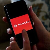 The Parler logo is displayed on a smartphone in Arlington, Virginia, July 2, 2020. (Olivier Douliery/AFP)