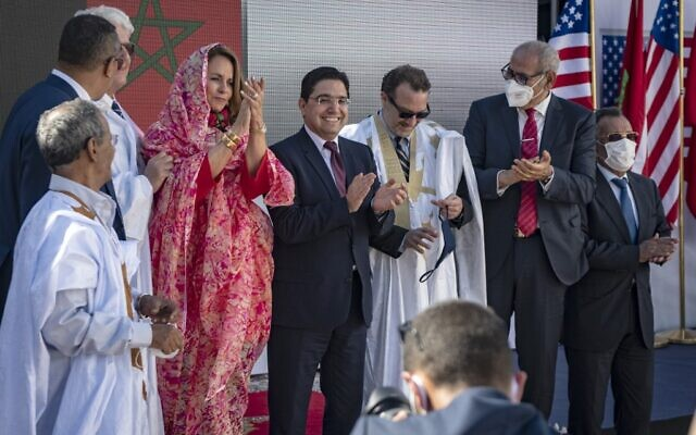 "Moroccan Foreign Minister Nasser Bourita (C) and David Schenker, US Assistant Secretary of State for Near Eastern Affairs - who is wearing a traditional dress for men called ""Darraa"" - (center-R) pose with other officials for a picture after their meeting in Dakhla, in Morocco-administered Western Sahara, on January 10, 2021. (Photo by Fadel SENNA / AFP)"