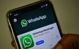 In this file photo taken on November 6, 2020 a user updates Facebook's WhatsApp application on his mobile phone in Mumbai (Indranil MUKHERJEE / AFP)