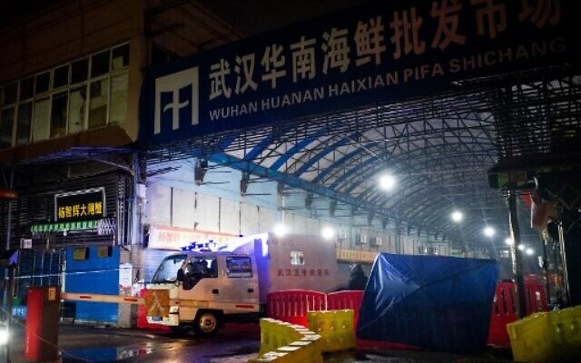 This file photo taken on January 11, 2020 shows members of staff of the Wuhan Hygiene Emergency Response Team leaving the closed Huanan Seafood Wholesale Market in the city of Wuhan, in Hubei, Province (NOEL CELIS / AFP)