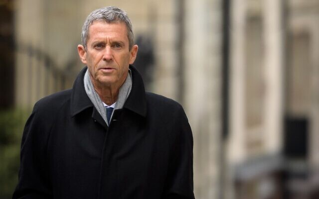 French-Israeli diamond magnate Beny Steinmetz returns to Geneva's courthouse during his trial over allegations of corruption linked to mining deals in Guinea, on January 11, 2021. (Fabrice Coffrini/AFP)