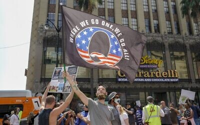 In this file photo conspiracy theorist QAnon demonstrators protest child trafficking on Hollywood Boulevard in Los Angeles, California, August 22, 2020 (Kyle Grillot / AFP)