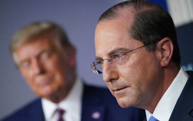 In this file photo Alex Azar, secretary of Health and Human Services (HHS), speaks as US President Donald Trump listens during an event on lowering prescription drug prices on November 20, 2020, in the Brady Briefing Room of the White House in Washington, DC (MANDEL NGAN / AFP)