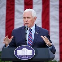 "In this file photo taken on November 13, 2020 US Vice President Mike Pence delivers an update on ""Operation Warp Speed"" in the Rose Garden of the White House in Washington, DC. - US Vice President Mike Pence on January 12, 2021, told House leaders he does not support invoking the 25th Amendment process to remove Donald Trump, all but guaranteeing an imminent impeachment vote against the president. (Photo by MANDEL NGAN / AFP)"