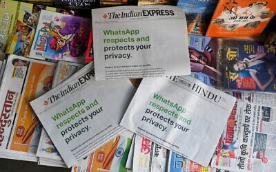 An advertisement from WhatsApp is seen in a newspaper at a stall in New Delhi on January 13, 2021. (Sajjad Hussain/AFP)