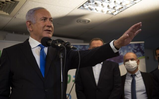 Prime Minister Benjamin Netanyahu visits a coronavirus vaccination facility in the northern Arab city of Nazareth on January 13, 2021. (Gil Eliyahu/POOL/AFP)