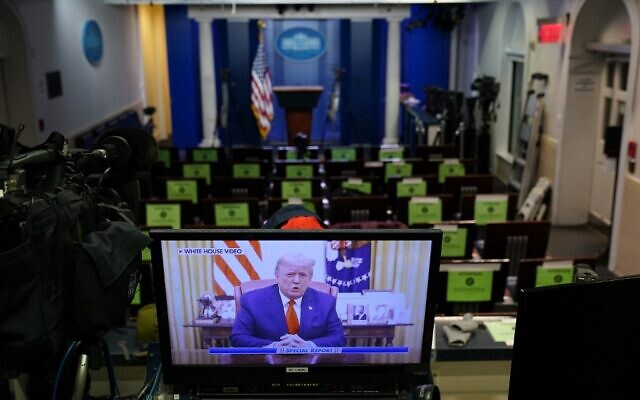 An image on a monitor shows US President Donald Trump speaking during in a video posted on the White House Twitter feed, in the empty Brady Briefing Room of the White House in Washington, DC on January 13, 2021 ( MANDEL NGAN / AFP)