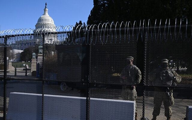Barbed wire is installed on the top of a security fence surrounding the US Capitol in Washington, January 14, 2021, ahead of next week's presidential inauguration of Joe Biden. (Andrew Caballero-Reynolds/AFP)
