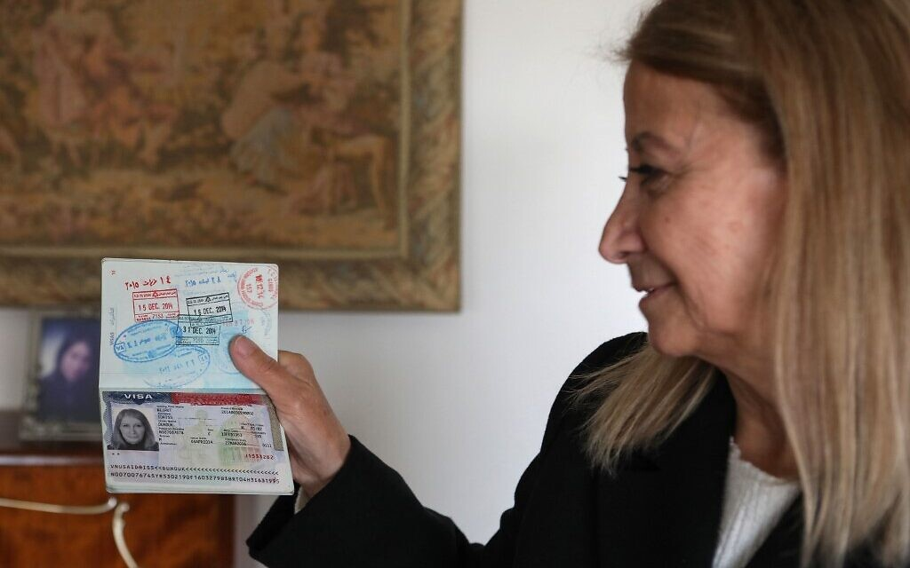Dahouk Idriss shows a page on her passport during an interview with AFP at her house in the Syrian capital Damascus on January 16, 2021. (Photo by LOUAI BESHARA / AFP)
