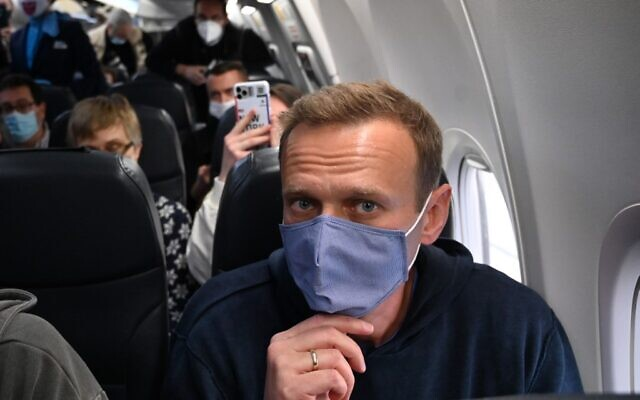 Russian opposition leader Alexei Navalny sits in a Pobeda airlines plane heading to Moscow before take-off from Berlin Brandenburg Airport (BER) in Schoenefeld, southeast of Berlin, on January 17, 2021. (Photo by Kirill KUDRYAVTSEV / AFP)