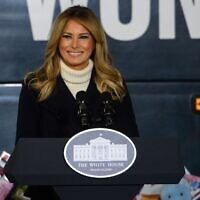 "In this file photo taken on December 8, 2020 US First Lady Melania Trump addresses the Marines Toys for Tots drive at Joint Base Base Anacostia Bolling in Washington, DC. - First Lady Melania Trump released a farewell message on January 18, 2021 as she prepares to leave the White House, saying that ""violence is never the answer,"" weeks after the president's supporters stormed the US Capitol. (Photo by NICHOLAS KAMM / AFP)"