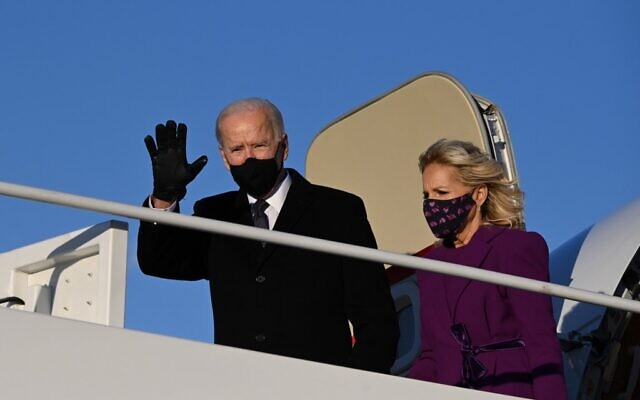 US President-elect Joe Biden and incoming First Lady Jill Biden arrive at Joint Base Andrews in Maryland on January 19, 2021, one day ahead of his inauguration as 46th President of the US. (Photo by JIM WATSON / AFP)