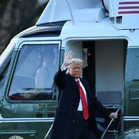 Outgoing US President Donald Trump waves as he boards Marine One at the White House for the last time as president, on January 20, 2021, in Washington. (Mandel Ngan/AFP)