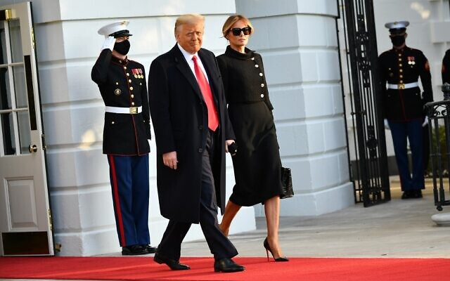US President Donald Trump and First Lady Melania make their way to board Marine One before departing from the South Lawn of the White House in Washington, DC on January 20, 2021 (MANDEL NGAN / AFP)