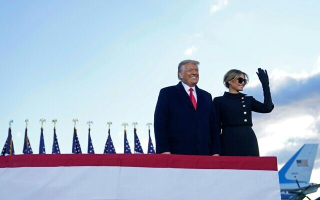 Outgoing US President Donald Trump and First Lady Melania Trump speak at Joint Base Andrews in Maryland on January 20, 2021. They headed to their Mar-a-Lago golf club residence in Palm Beach, Florida, skipping the inauguration of President-elect Joe Biden. (ALEX EDELMAN / AFP)