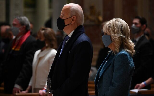 US President-elect Joe Biden (C) and incoming first lady Jill Biden attend Mass at the Cathedral of St. Matthew the Apostle in Washington on January 20, 2021. (Jim Watson/AFP)