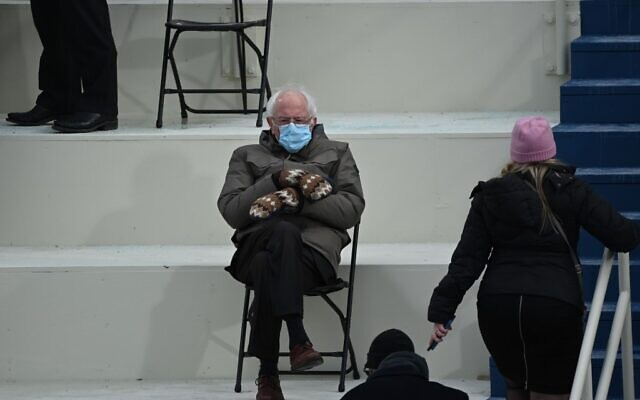 Former presidential candidate, Senator Bernie Sanders (D-Vermont) sits in the bleachers on Capitol Hill before Joe Biden is sworn in as the 46th US President on January 20, 2021, at the US Capitol in Washington, DC. (Photo by Brendan SMIALOWSKI / AFP)