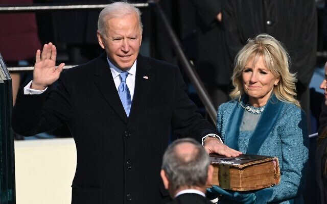 Joe Biden, flanked by incoming US First Lady Jill Biden, is sworn in as the 46th US President by Supreme Court Chief Justice John Roberts on January 20, 2021, at the US Capitol in Washington, DC. (SAUL LOEB / POOL / AFP)