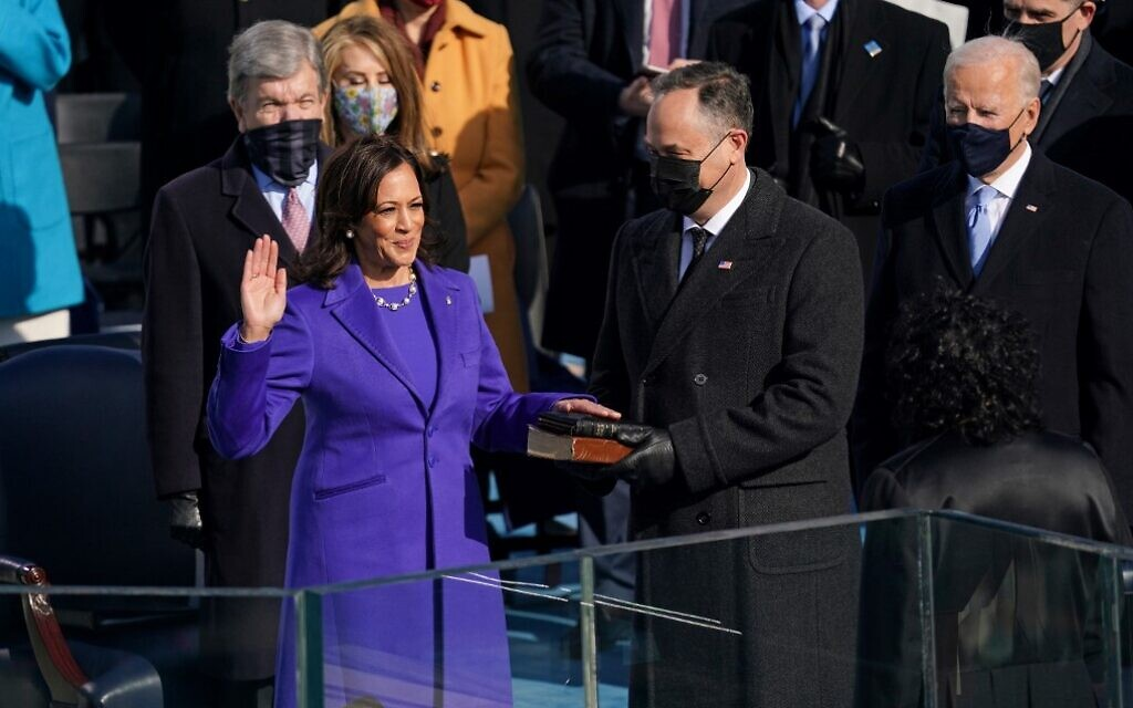 Kamala Harris (L), with her husband  Doug Emhoff (C), is sworn in as US vice president by Justice Sonia Sotomayor (R) on January 20, 2021, at the US Capitol in Washington. (Andrew Harnik and Erin Schaff/Pool/AFP)
