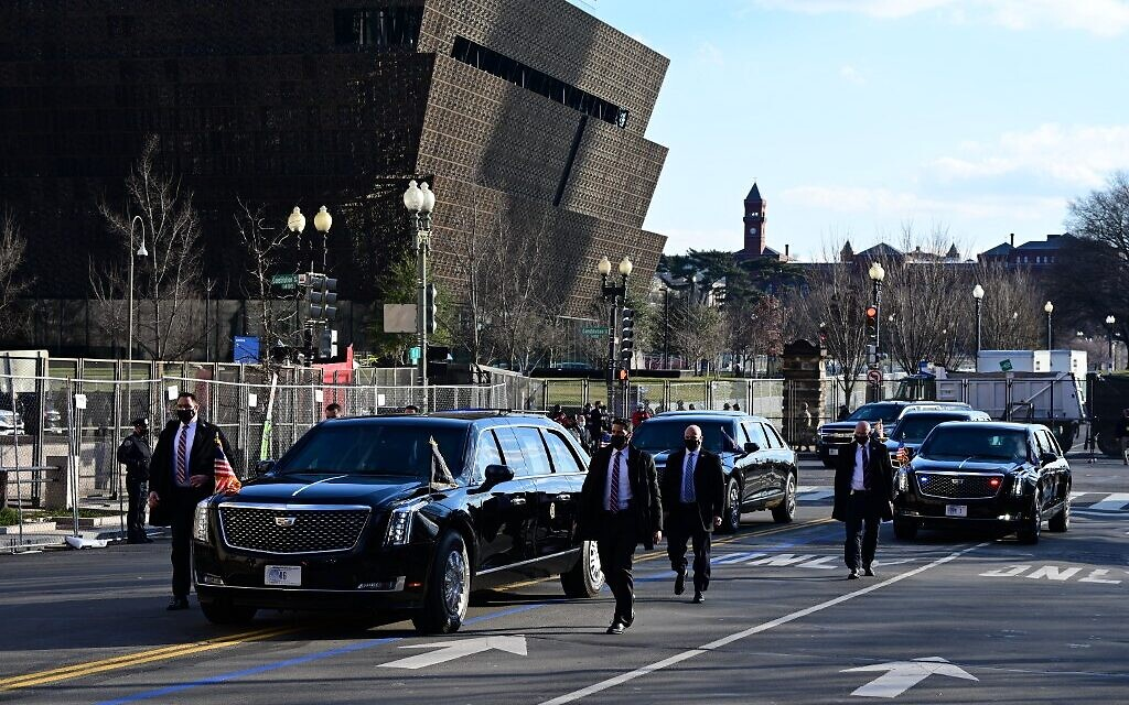 The motorcade with US President Joe Biden and US Vice President Kamala Harris heads to the White House past the National Museum of African American History and Culture in Washington, DC, on January 20, 2021. (JIM WATSON / AFP)