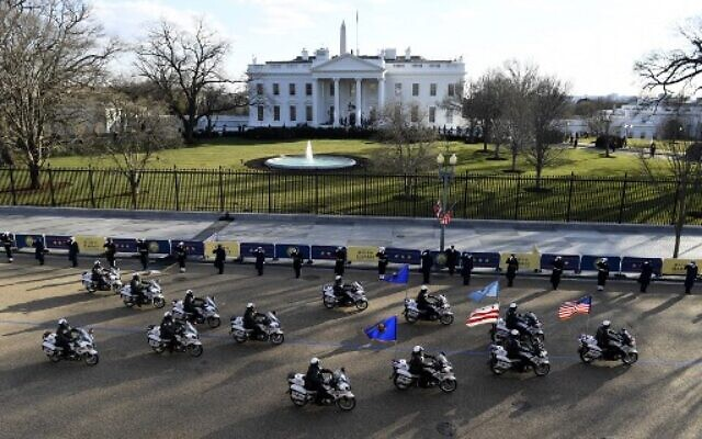 Motorcycle police parade along the White House in Washington, DC, after US President Joe Biden and US Vice President Kamala Harris were sworn in at the US Capitol on January 20, 2021. (Patrick T. FALLON / AFP)