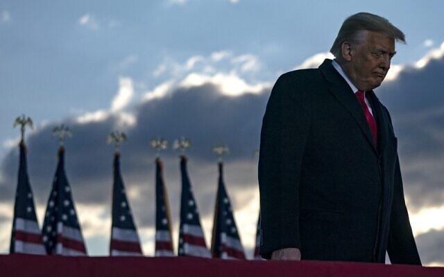 Outgoing US President Donald Trump addresses guests at Joint Base Andrews in Maryland on January 20, 2021. (ALEX EDELMAN/AFP)