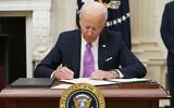 US President Joe Biden signs executive orders as part of his administration's COVID-19 response, in the State Dining Room of the White House in Washington, on January 21, 2021. (Mandel Ngan/AFP)