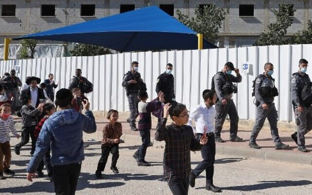 Israeli security forces leave the vicinity of a Jewish Talmudic school which is open in violation of COVID-19 lockdown rules in Ashdod on January 22, 2021. (JACK GUEZ/AFP)